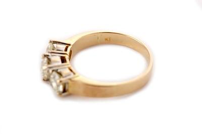 Lot 15 - A diamond three-stone ring