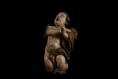 Lot 15 - AN EARLY 17TH CENTURY SOUTH GERMAN POLYCHROME DECORATED AND CARVED WOOD FIGURE OF A CHERUB