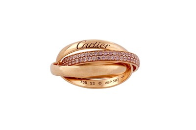 Lot 13 - Cartier   A rose gold and pink sapphire  'Trinity' ring, 2015