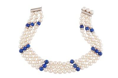 Lot 64 - John van der Vet | A cultured pearl, lapis lazuli and diamond choker