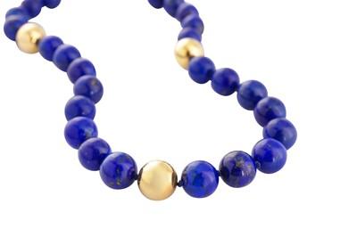 Lot 75 - A lapis lazuli and diamond necklace