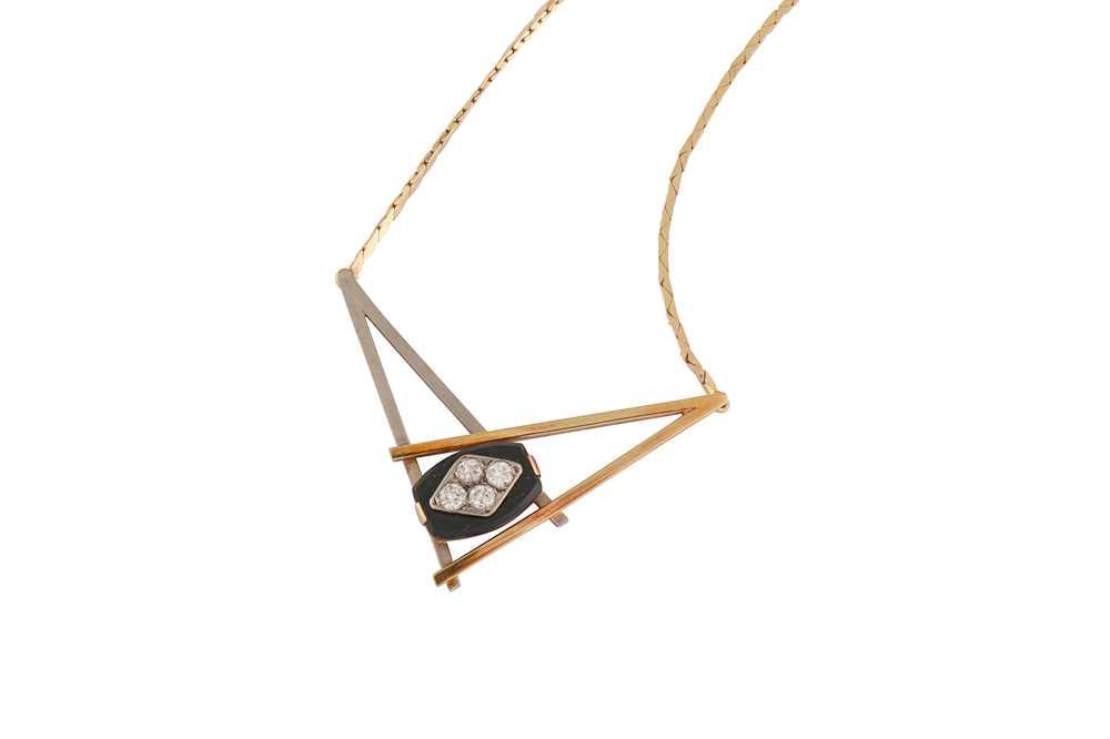 Lot 35 - An onyx and diamond pendant