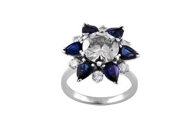 Lot 71 - A sapphire and diamond dress ring