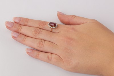 Lot 24 - A ruby and diamond cluster ring