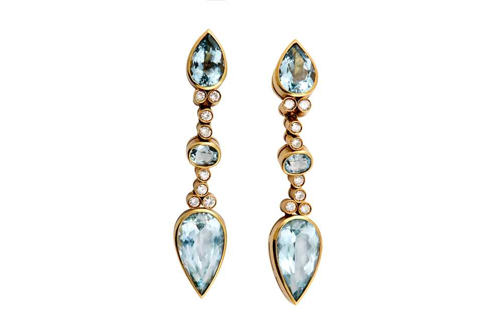 Lot 48 - A pair of blue topaz and diamond earrings
