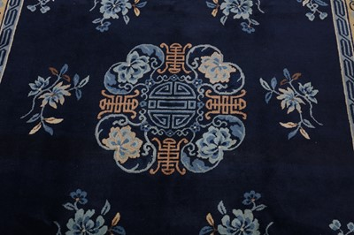 Lot 27 - A CHINESE CARPET