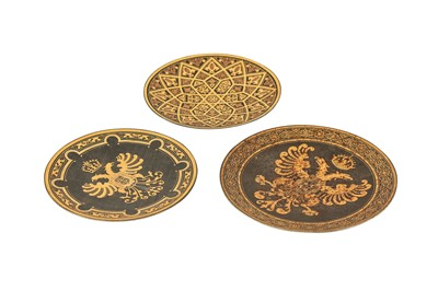 Lot 317 - THREE TOLEDO SILVER AND GOLD-DAMASCENED STEEL SAUCERS