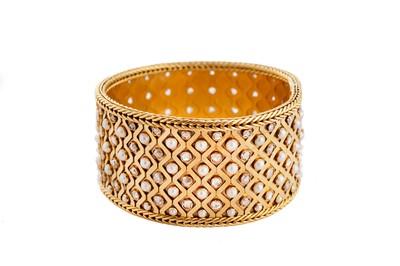 Lot 200 - A pearl and diamond strap bracelet, circa 1890-1915