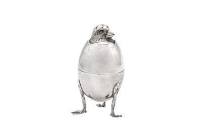 Lot 95 - An early 20th century French 950 standard silver novelty egg cup and cruet, Paris circa 1900 by Emile Francois