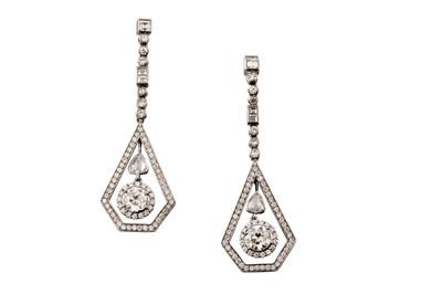 Lot 11 - A pair of diamond pendent earrings