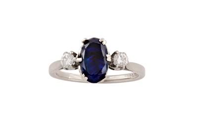 Lot 58 - A sapphire and diamond three-stone ring
