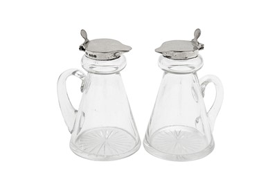 Lot 79 - A pair of George VI sterling silver mounted glass whiskey noggins, Birmingham 1938 by Hukin and Heath