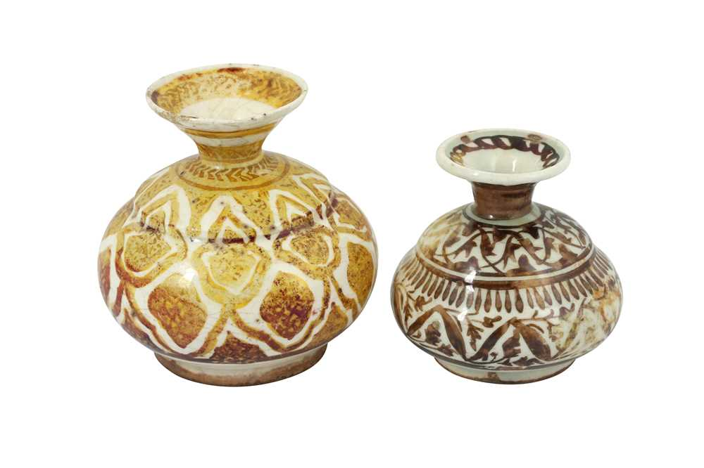 Lot 106 - TWO SAFAVID COPPER LUSTRE-PAINTED POTTERY BOTTLES