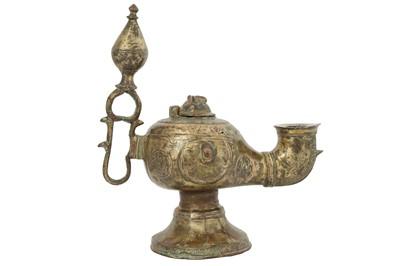 Lot 102 - A KHORASAN-REVIVAL COPPER-INLAID BRASS OIL LAMP