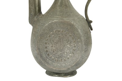 Lot 105 - A QAJAR GOLD-DAMASCENED STEEL EWER AND AN ENGRAVED TINNED COPPER EWER