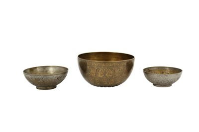 Lot 121 - FIVE ENGRAVED BRASS MAGIC BOWLS AND A QAJAR BOWL WITH FIGURAL DECORATION