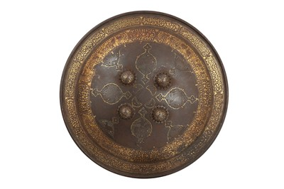Lot 118 - A QAJAR GOLD-DAMASCENED STEEL SHIELD WITH OPENWORK MEDALLIONS