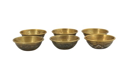 Lot 122 - SIX SMALL MAMLUK-REVIVAL COPPER AND SILVER-INLAID CAIROWARE BRASS BOWLS