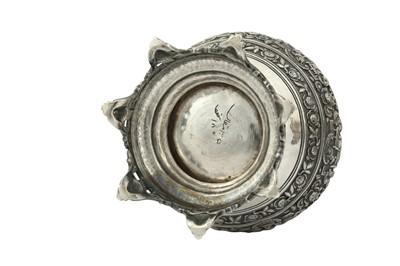 Lot 136 - A PAIR OF QAJAR REPOUSSÉ SILVER VASES WITH MYTHOLOGICAL ACHAEMENID-REVIVAL SCENES