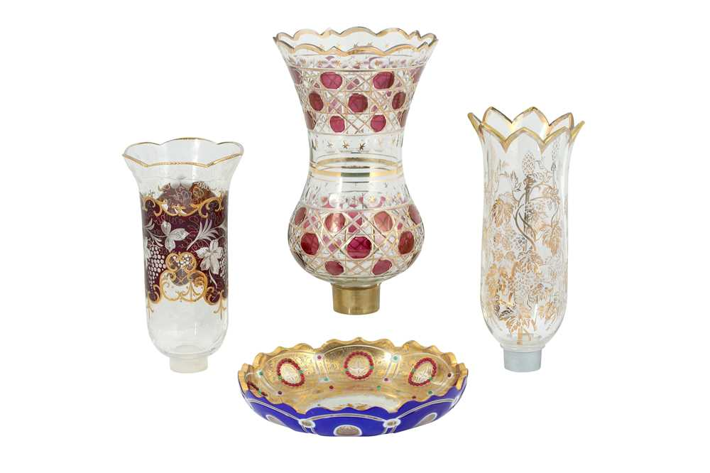 Lot 133 - THREE WHEEL-CUT, DIAMOND-CUT AND GILT GLASS LAMP COVERS AND A DISH