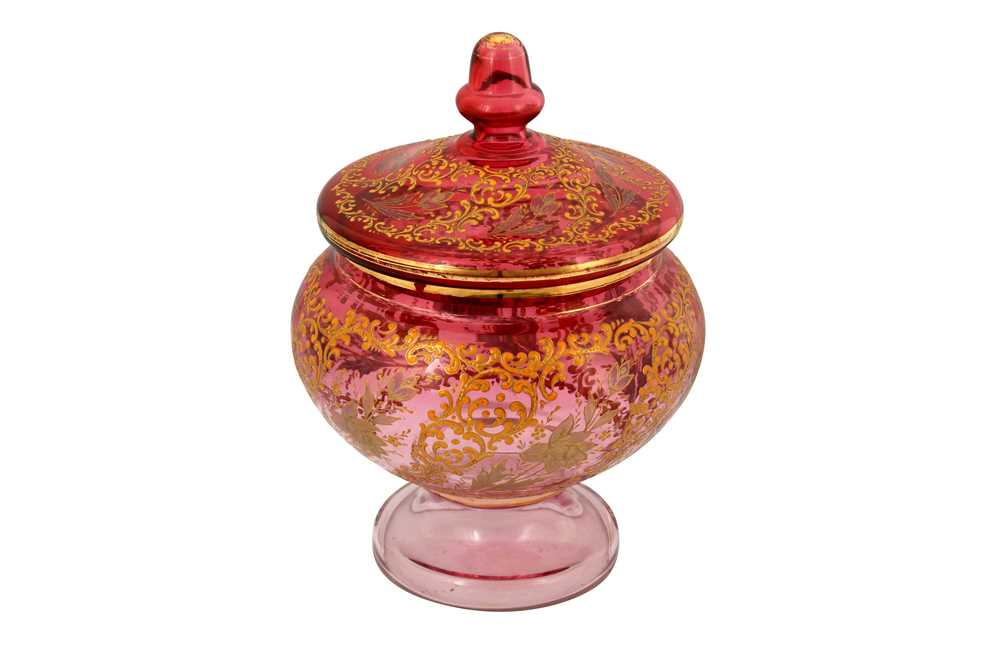 Lot 128 - A LARGE GILT AND ENAMELLED PINK GLASS LIDDED BOWL