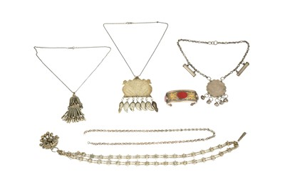 Lot 177 - A GROUP OF FIVE SILVER AND WHITE METAL NECKLACES AND A CARNELIAN-ENCRUSTED TURKMEN BANGLE