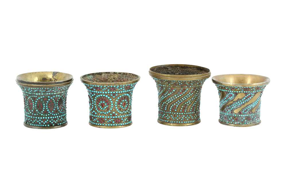 Lot 147 - FOUR GLASS BEAD AND TURQUOISE-SET BRASS QALYAN CUPS