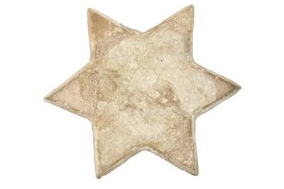 Lot 310 - AN ILKHANID COPPER LUSTRE STAR POTTERY TILE
