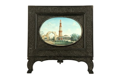 Lot 370 - λ A LARGE OVAL IVORY MINIATURE OF THE QUTB MINAR COMPLEX IN DELHI