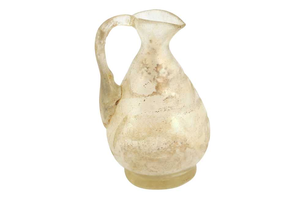 Lot 301 - A MINIATURE MOULD-BLOWN WHEEL-CUT TRANSPARENT GLASS EWER