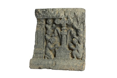 Lot 300 - A GREY SCHIST RELIEF OF WORSHIPPERS AROUND A PILLAR