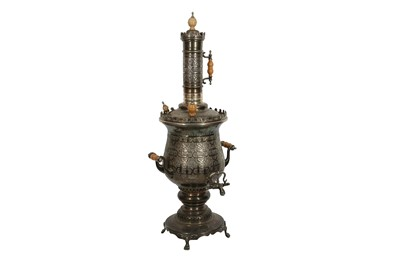 Lot 630 - A LARGE PLATED BRASS SAMOVAR ENGRAVED WITH ISLAMIC MOTIFS