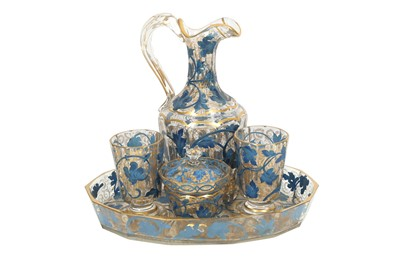 Lot 631 - A GILT AND BLUE-PAINTED TRANSPARENT GLASS DRINKING SET MADE FOR THE MIDDLE EASTERN MARKET