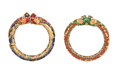 Lot 363 - TWO GILT AND POLYCHROME-ENAMELLED BANGLES WITH PARROT HEADS