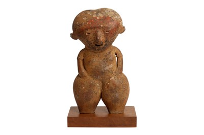 Lot 76 - A POTTERY FIGURE OF A FEMALE, POSSIBLY PRE-COLUMBIAN