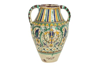 Lot 643 - A POLYCHROME-PAINTED CHEMLA POTTERY WATER JUG