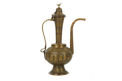 Lot 623 - A ZAND-STYLE SILVER-INLAID BRASS EWER MADE FOR THE IRANIAN MARKET