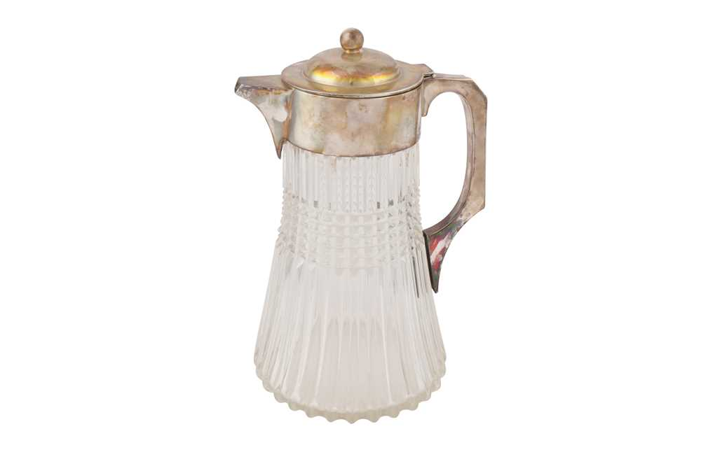 Lot 31 - A LARGE GLASS AND SILVER PLATED WATER JUG, 20TH CENTURY
