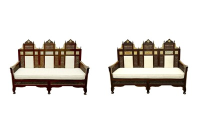 Lot 637 - λ A NEAR PAIR OF MOTHER-OF-PEARL AND BONE-INLAID ORIENTALIST MASHRABIYA-STYLE SETTEES
