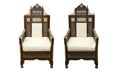 Lot 633 - λ A PAIR OF MOTHER-OF-PEARL AND BONE-INLAID ORIENTALIST MASHRABIYA-STYLE ARMCHAIRS