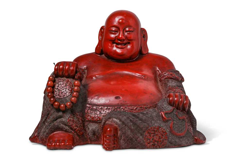Lot 45-A CHINESE CINNABAR LACQUER FIGURE OF BUDAI HESHANG.
