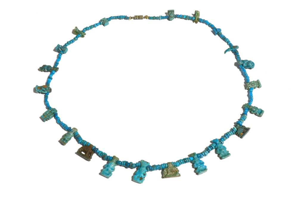 Lot 31 - AN EGYPTIAN MUMMY BEAD NECKLACE Middle Kingdom,...