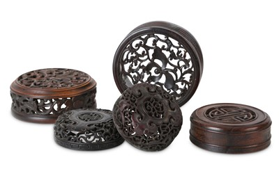 Lot 369 - FIVE CHINESE WOOD JAR COVERS.