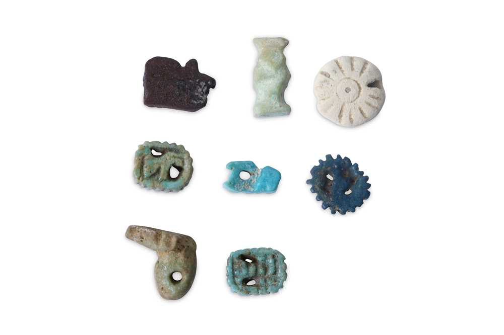 Lot 26 - A GROUP OF EGYPTIAN AMULETS Circa 1st...
