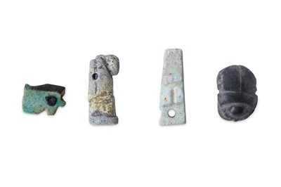 Lot 23 - A GROUP OF EGYPTIAN FRIT AMULETS Late Period,...
