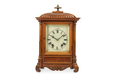 Lot 36 - A LATE 19TH CENTURY WALNUT MANTEL CLOCK the...